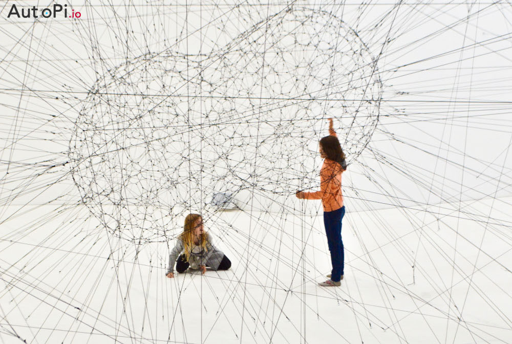 Two kids being surrounded by endless number of lines that represent the creativity and limitless options