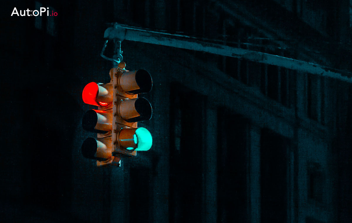 A dark image of the traffic lights turned both red and green on two different sides