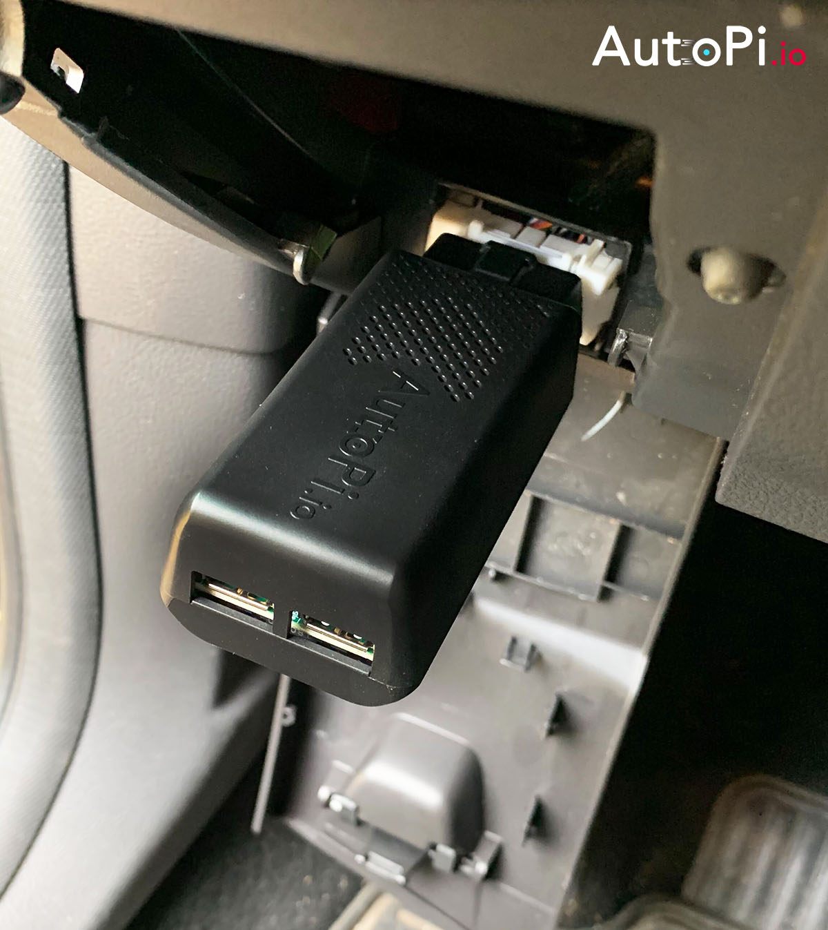 A detailed shot of AutoPi telematics unit generation 2 plugged into obd 2 port